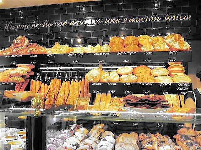 Ein mit Liebe zubereitetes Brot ist eine einzigartige Kreation! ist auf den Kacheln zu lesen und ganz in unserem Sinne